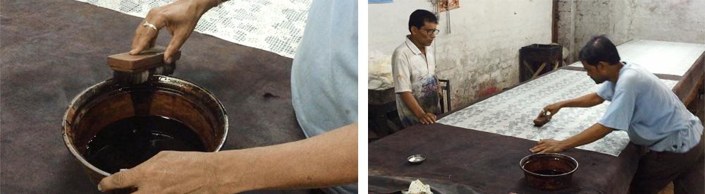 刷毛目のペインティングをほどこしているところ。左側に立つ人は、作業ポイントを指で示しています。